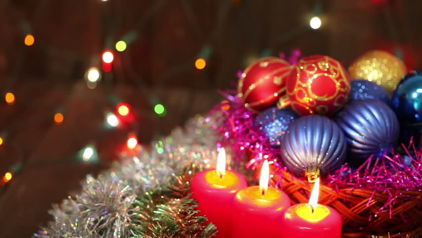 Burning candles and Christmas decorations. Christmas still life
