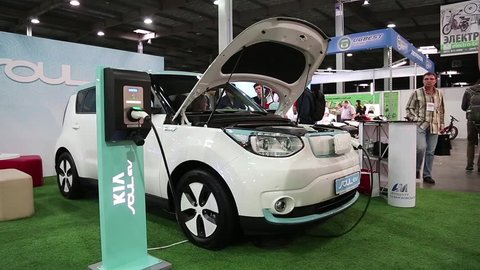UKRAINE, KIEV, JUNE 10, 2016: People at exhibition of electric cars. People near KIA Soul EV electromobile