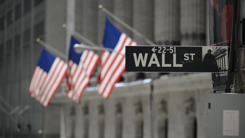 Wall Street sign with American flags purposely blurred in background, HD video #18977830