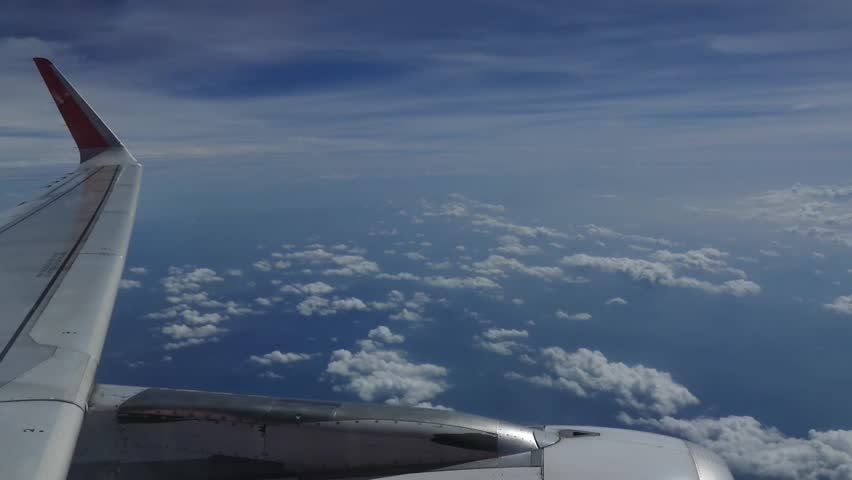 The wing of a plane flying over the sky with clouds beautiful atmosphere. #18984880