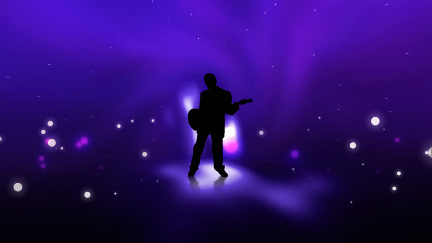 Guitarist playing on stage with shiny lights and effects | Shutterstock HD Video #18999130