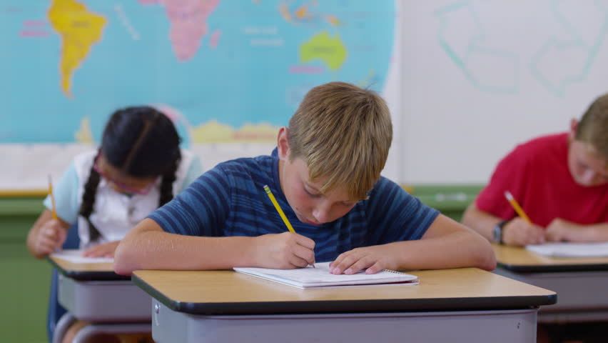 Teacher helping student with writing project in school classroom   Shutterstock HD Video #19004710