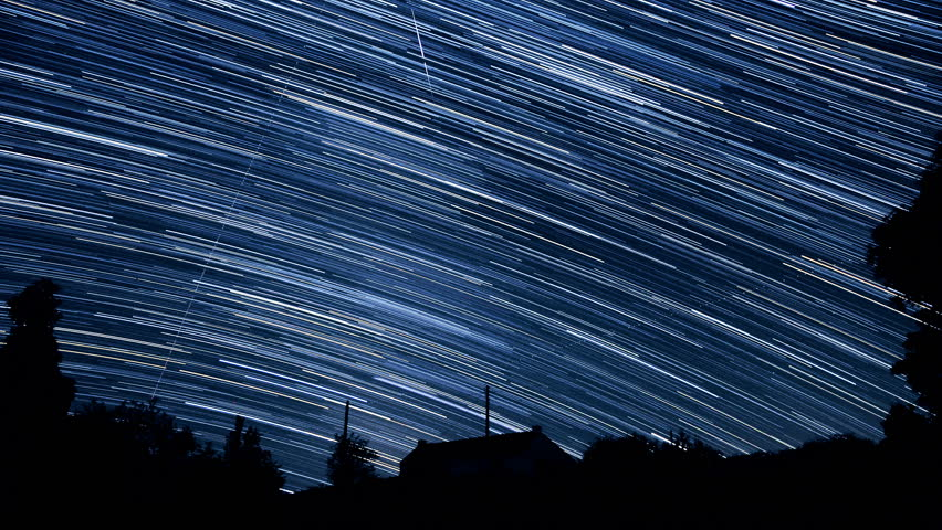 """Long luminous tracks of stars in the sky - Starry night sky in timelapse - ISS is appearing at 2""""17 - Looking to southwest from Western Europe above an isolated house in countryside."""