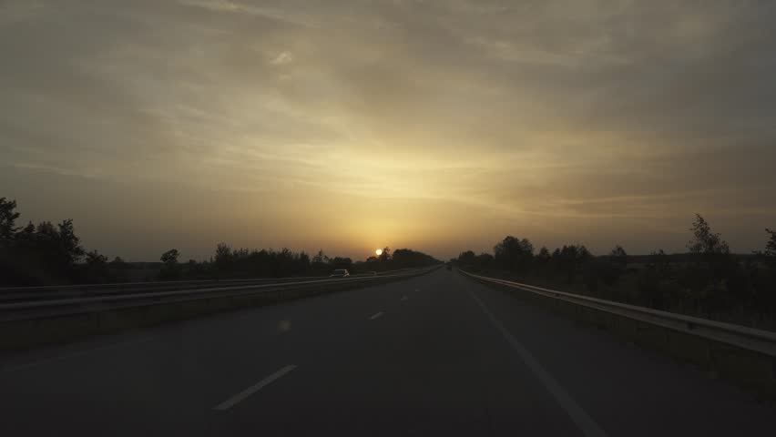 Evening on highway. View moving cars with sunset at background, shot taken from windshield | Shutterstock HD Video #19038100