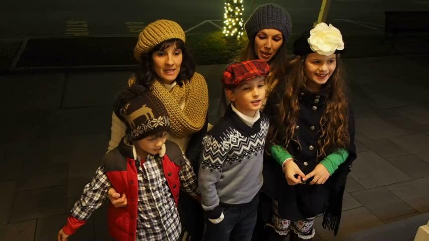 Family Singing Christmas Carols On Front Porch At Night Stock ...