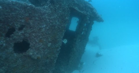 Ocean scenery wheelhouse and partially buried bow, on wreckage, 4K UltraHD, UP36161