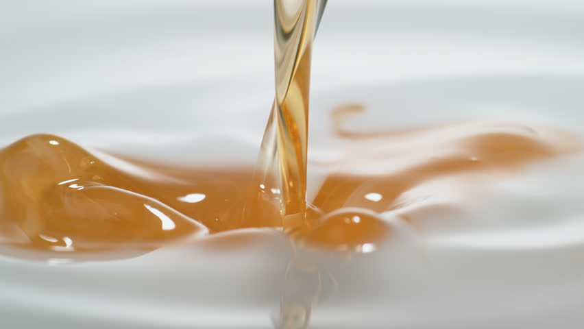 Pouring oil into milk. Shot with high speed camera, phantom flex 4K. Slow Motion.