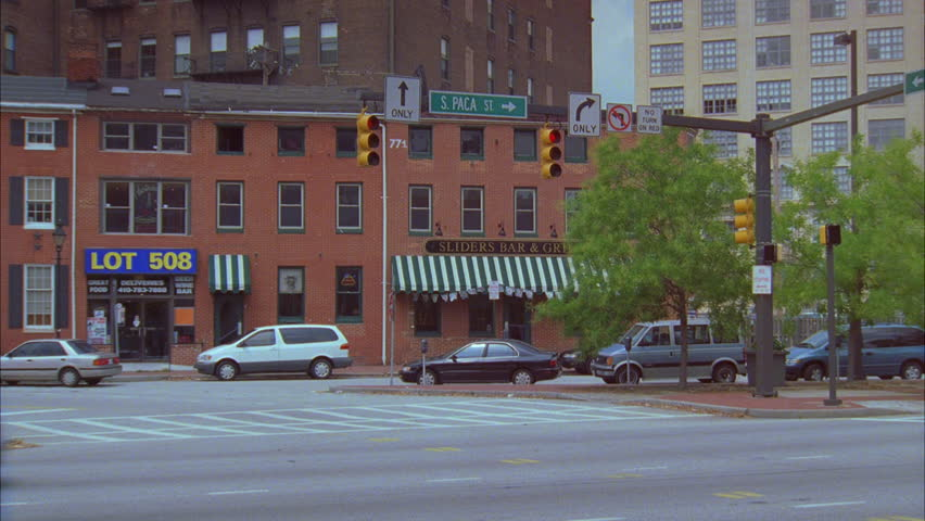 Day pan right ND downtown city street Camden St sign Orioles banner  Baltimore   HD stockDay Tilt Up From Green Canopy Covered Entrance Side Raked Left 14  . Brick Apartment Building Entrance. Home Design Ideas