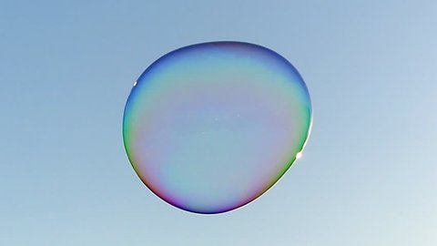 a Huge Soap Bubble Floating in the Sky. the Action in Slow Motion.