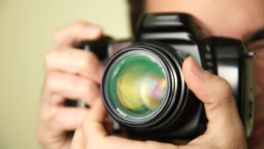Photographer takes pictures with DSLR camera. #1912846