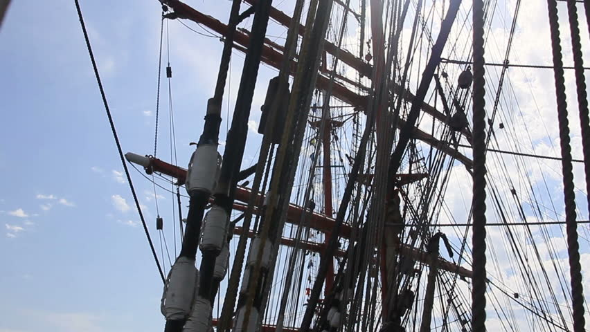 Ropes on a wooden mast in bright sunbeams | Shutterstock HD Video #19182640