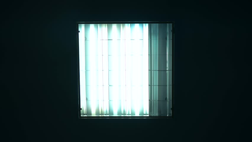 Fluorescent lights turning on and off