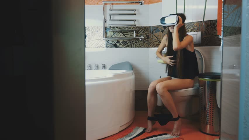 Woman Sitting On Toilet Stock Video Footage - 4K and HD