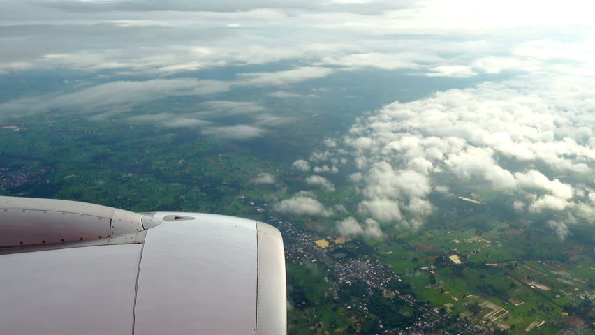 View through airplane window. Beautiful clouds with earth impressive #19248100