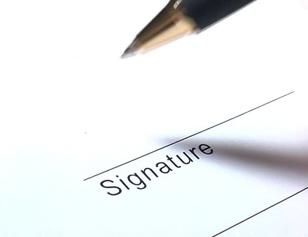 Closeup of signature writing