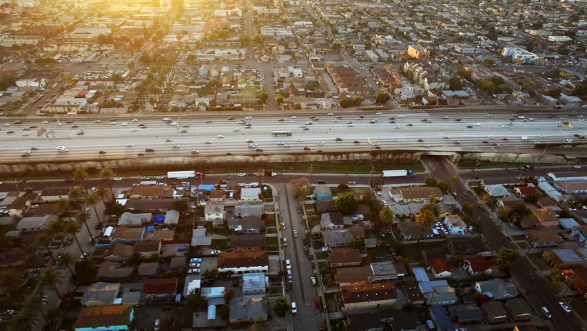 Freeway at sunset in Los Angeles, California. traffic passing by. Aerial footage. United States. | Shutterstock HD Video #19331350
