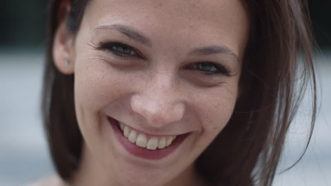 Portrait of Attractive Smiling Caucasian Ethnicity Young Woman in Urban Environment. Shot on RED Cinema Camera in 4K (UHD).