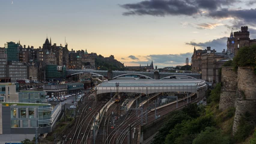 Beautiful sunset above the skyline of Edinburgh - Scotland´s capital. Moon is setting above the Edinburgh Castle.