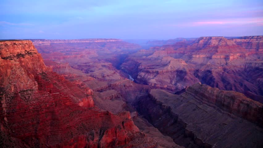 Sunrise at Grand Canyon with colorful rocks and sky. The Grand Canyon is one of the most remarkable natural wonders in the world, attracting about five million visitors per year.