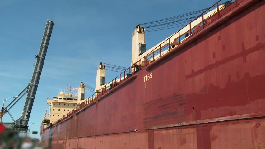 Time-Lapse of Lake Freighter or Cargo ship, moving slowly along the Welland Canal after just leaving Lock No. 1 on it's way towards Lake Erie.