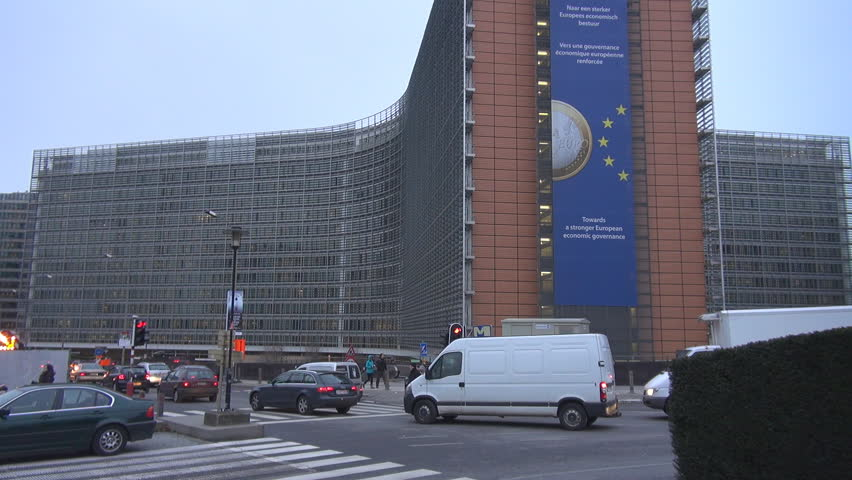 BRUSSELS, BELGIUM - DECEMBER 19, 2011: Vehicles pass European Commission