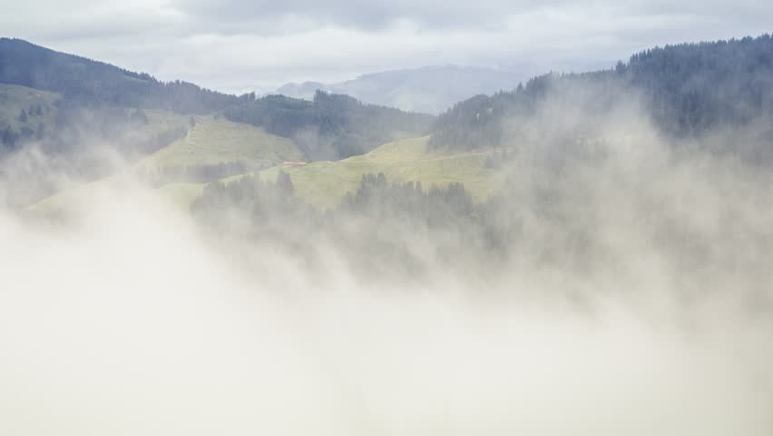 Timelapse of morning fog rolling through vallery, green forest, mountains. #19428430