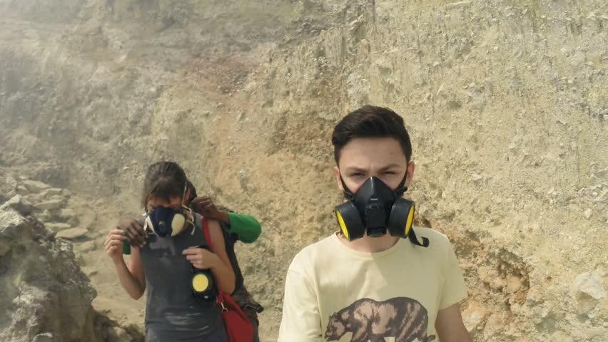 Stock Video Clip Of Teenager In Gas Mask Walking Down Ijen
