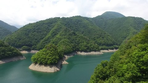 Okutama Lake aerial view moving forward
