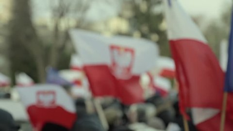 Demonstration to Defend Democracy in Warsaw, Poland. December 12th, 2015. Polish and European Flags outside the Polish Parliament. Shifting focus.