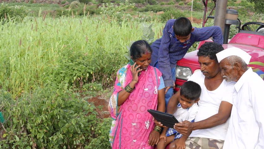 4k Footage of Real farmer family in Veer, Maharashtra using modern technology like Tab and lap top.