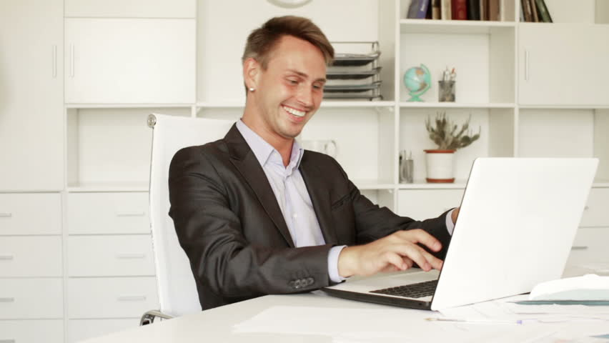 beautiful bright office. cheerful man in formalwear sitting and working with computer at company office hd stock video beautiful bright e