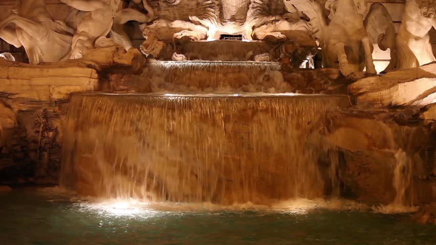 Video clip showing a detail of Trevi Fountain by night. Rome, Italy.