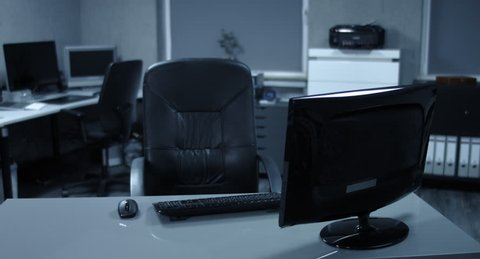 4K: A young woman sits down to her computer workstation and starts to read her mails and to answer. Besides, she is surely relaxed in a modern office.