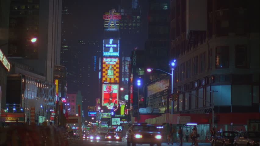night Times Square street w jumbotron, car traffic taxi cabs, New York rake street #19602250