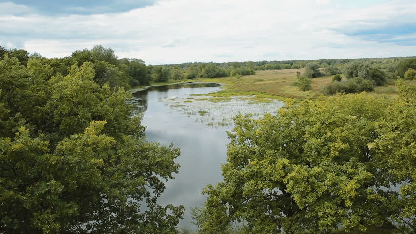 aerialshot of a small peaceful river in summer