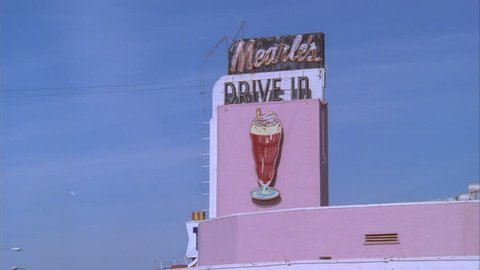 day Tight sign Mearle's pink 50's style drive diner w small town look