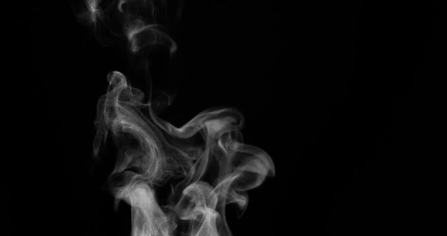 Rich Steam from a Cup of Tea. White steam rises light, graceful twists on a black background. Shooting at a rate of 120fps. Footage is perfect for the top layer with different blending modes #19641040