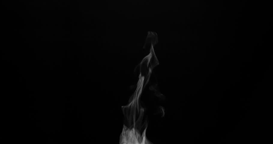Thin Trickle of Steam from a Cup of Coffee. White steam rises light, graceful twists on a black background. Shooting 120fps. Footage is perfect for the top layer with different blending modes #19649710