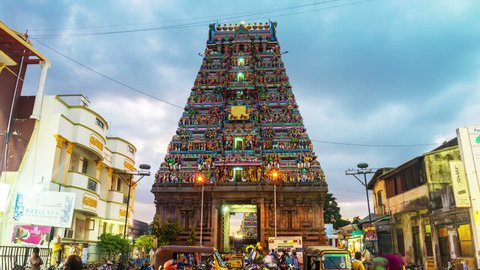 CHENNAI, INDIA - JULY 1, 2016: Famous Arulmigu Kapaleeswarar Temple in Tamil Nadu at night. Time-lapse of illuminated entrance with nightlife around