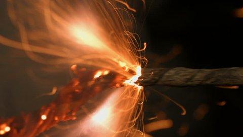 Lit fuse burning on a black background