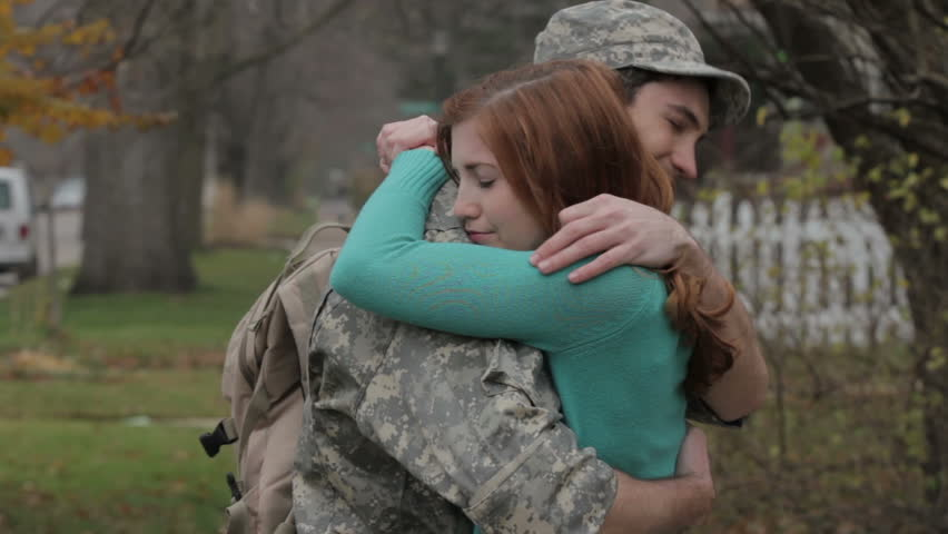 Soldier saying goodbye to his wife, then leaving