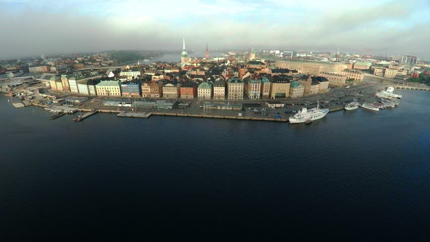 Aerial view. Stockholm. Old houses, buildings and streets. City center. Gamla Stan. Sweden. Shot in 4K (ultra-high definition (UHD).