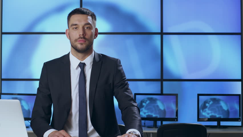 Male News Presenter in Broadcasting Studio. Shot on RED Cinema Camera in 4K (UHD).