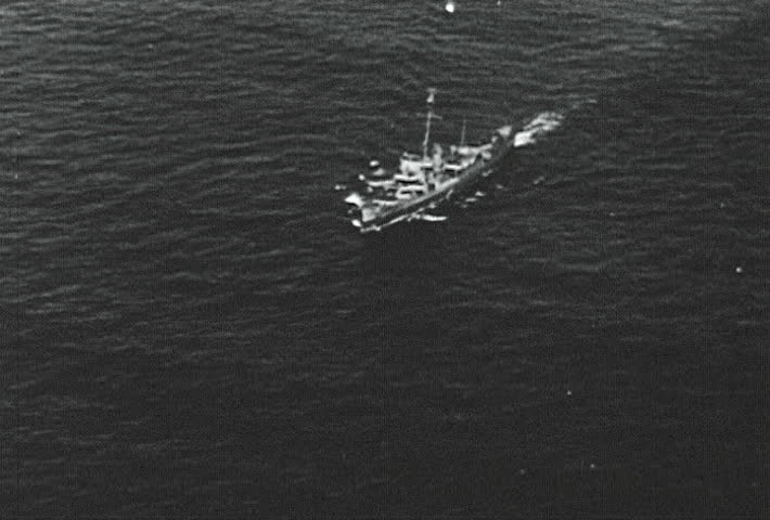 ATLANTIC OCEAN - CIRCA 1942-1944: World War II, Filmed From The Air Tilting Up Naval Convoy, publisher National Broadcasting Service (U.S.)  - SD stock video clip