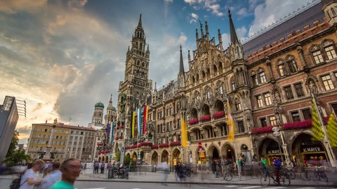 MUNICH, GERMANY - JULY 28, 2016: People in Marienplatz on the the famous Town Hall at evening, Munich, Germany. Timelapse view in 4K.