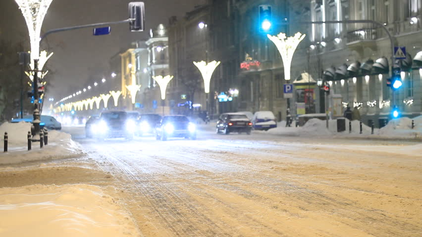 City traffic in snowfall