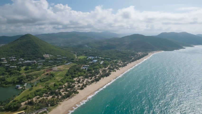 Aerial view of the mountain landscape and coastline of beautiful tropical Hainan island in the South China Sea.