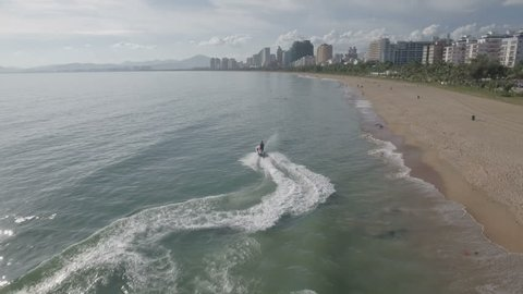 Tracking a jet ski at the beach of Sanya, a popular holiday destination on Hainan island in the South China Sea.