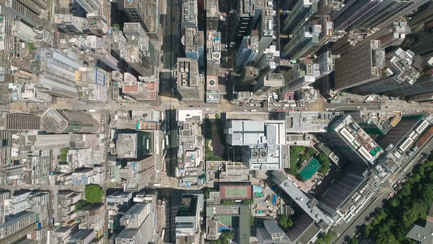 Abstract aerial drone footage of rooftops and streets in the densely populated Kowloon area in Hong Kong, one of Asia's most iconic modern cities.   Shutterstock HD Video #19843231