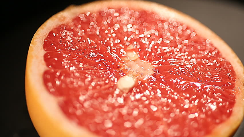 Delicious grapefruit cut for squeezing fresh juice, citrus fruit in healthy menu. Vitamin C source, citric acid nutrition, lowering cholesterol level, antioxidant. Burning fat food, diet calories
